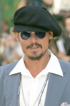 Johnny Depp - Londra - 17-07-2005 - L'ultimatum di Vanessa Paradis a Johnny Depp: porta via tutti quei cappelli