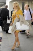 Pamela Anderson - Los Angeles - 09-11-2009 - Il giallo, un trend perchè torni a splendere il sole