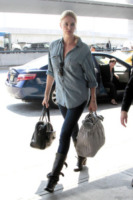 Charlize Theron - New York - 19-03-2012 - Vic Beckham, la più chic in aeroporto secondo British Airways