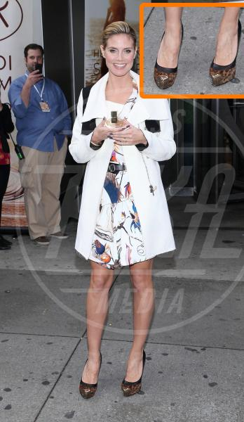 Heidi Klum - New York - 01-12-2011 - In punta di piedi… e di metallo!