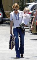 Xander, January Jones - Los Angeles - 10-06-2013 - Corsi e ricorsi fashion: dagli anni '70 ecco i pantaloni a zampa