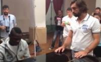 Andrea Pirlo, Mario Balotelli - Milano - 06-08-2013 - Mario Balotelli fa goal pure con lo spartito musicale