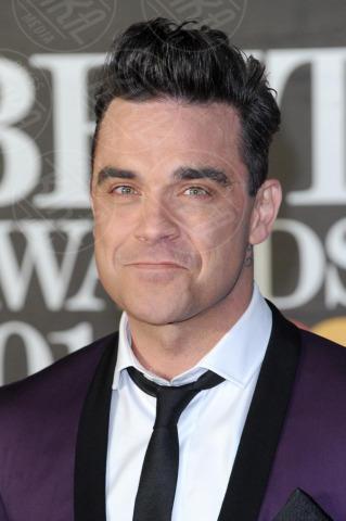 Robbie Williams - Londra - 20-02-2013 - I colpi di testa, o di sole, degli uomini dello showbiz