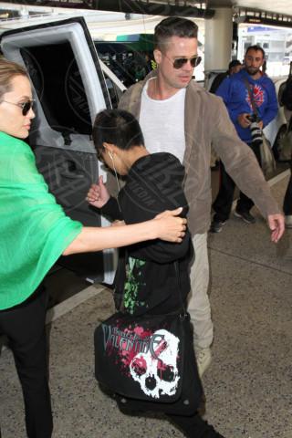 Pax Thien Jolie Pitt, Angelina Jolie, Brad Pitt - Los Angeles - 05-02-2014 - Brad Pitt e Angelina Jolie fanno rientro a Los Angeles