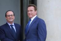 François Hollande, Arnold Schwarzenegger - Parigi - 10-10-2014 - Schwarzenegger e Hollande: la strana coppia
