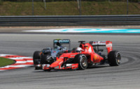 Nico Rosberg, Sebastian Vettel - Sepang - 29-03-2015 - Gp Qatar: Sebastian Vettel riporta alla vittoria la Ferrari