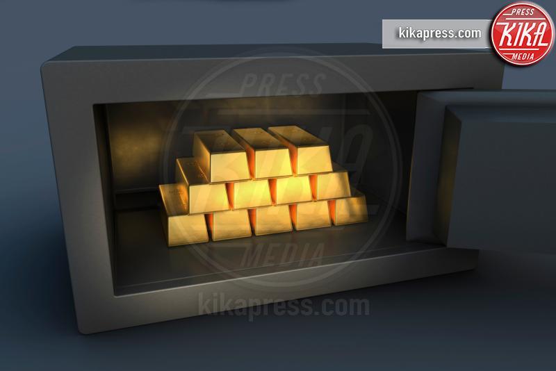 Gold ingots inside open security safe - 15-05-2017 - Investimenti a lungo termine: l'oro conviene ancora?