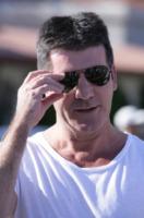 Simon Cowell - Malibu - 14-03-2010 - Simon Cowell triste per la morte di una piccola fan: aveva appena cantato per lui