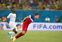 BESLER, Asamoah Gyan - Natal - 16-06-2014 - Brasile 2014: gli Stati Uniti esordiscono con il Ghana