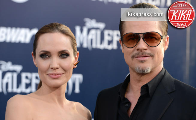 ANGELINA JOLIE + BRAD PITT @ the premiere of 'Maleficent' held @ the El Capitan theatre. May 28, 2014